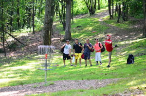 Holing out for birdie, hole 13, Newton Hill Open 2014